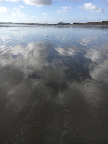 Co.Cork_Garryvoe_Beach_clouds_mirrored_in_low_tide